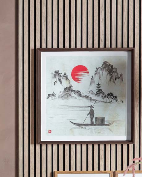 a Japandi wall art picture of a fisherman on a lake overlooking mountains and a red sun