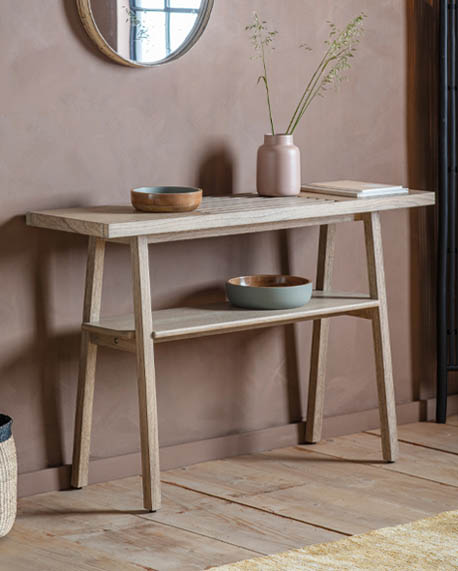 a minimalist, light wood console table in Japandi style