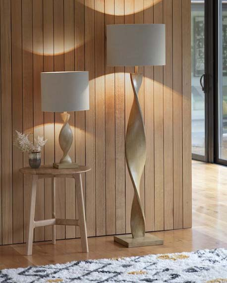 wooden Japandi lighting including a table lamp and matching floor lamp in a contemporary house with panelled wall
