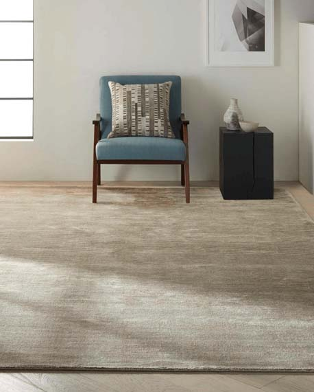 a plain Japandi style rug in a neutral room by Calvin Klein with blue chair