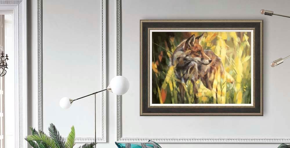 Debbie Boon 'Fox in Dappled Sunlight' framed print on a neutral panelled wall