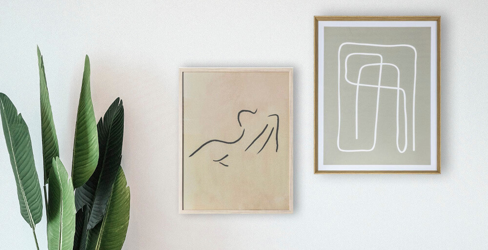 Wall with a pair of minimalist line art framed prints