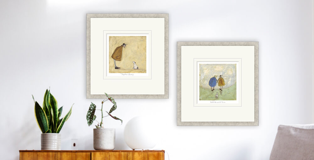 Sam Toft prints 'Together Always' and 'Until the End of Time' in a neutral home with mid-century furniture